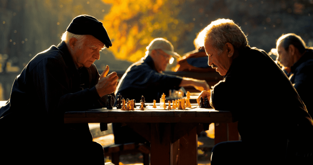 Two Elderly gentleman playing chess and learning about assisted living lingo