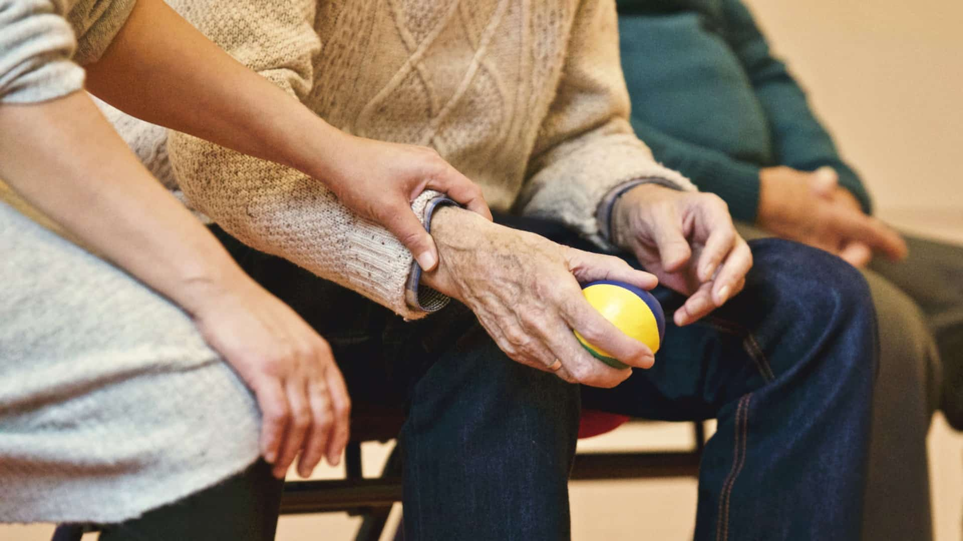 An Assistant helping an elderly woman