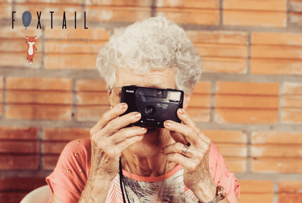 An Elderly lady with a camera