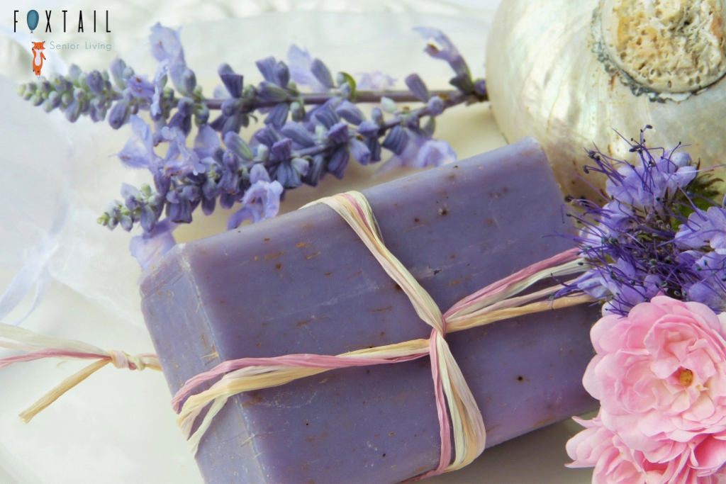 a purple bar of soap with lavender around it.