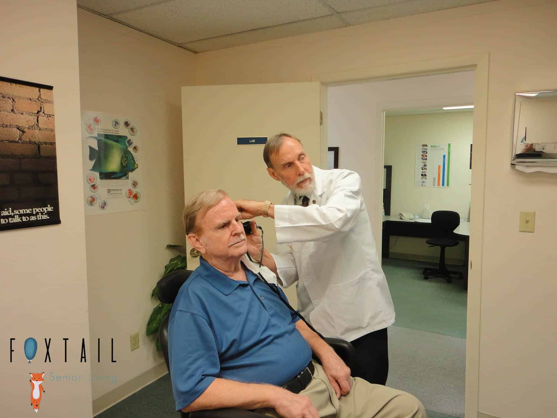 Elderly man getting a hearing test in a doctor's office.