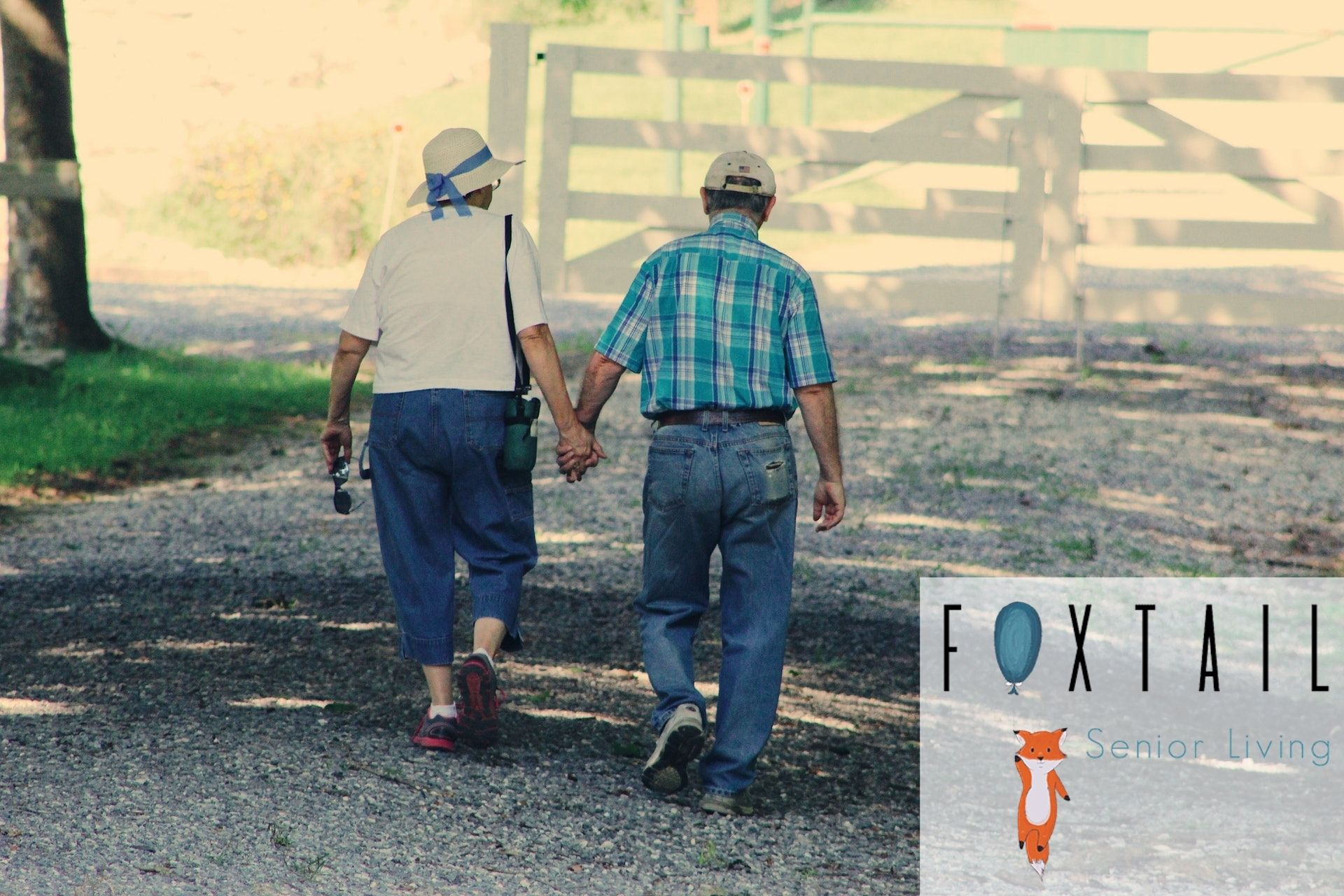 An older couple walking down a gravel road