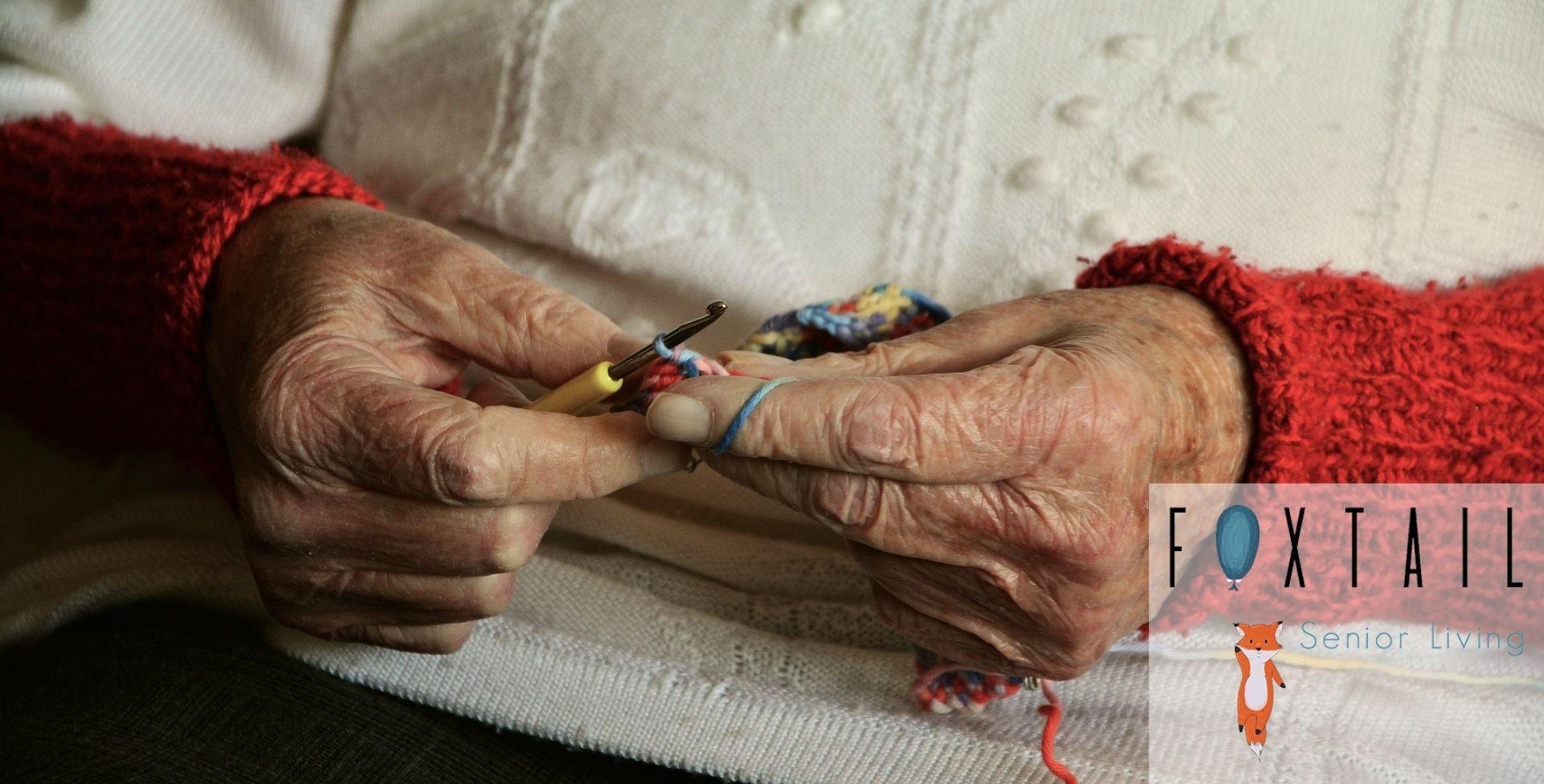 Elderly Woman Crocheting Yarn