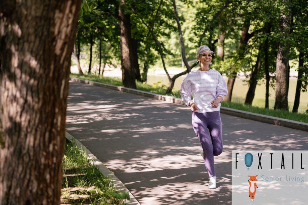 Elderly woman running on a trail.
