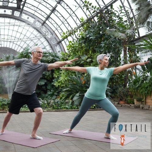 a senior couple doing yoga in a greenroom